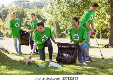 Environmental activists picking up trash on a sunny day