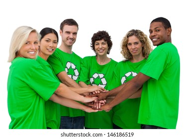 Environmental activists putting their hands together on white background