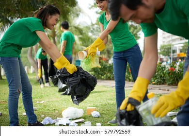 Environmental activists wrapped up in work: they divided into pairs and collecting garbage in city park