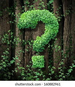 Environmental conservation concept as a forest of trees and a green vine growing into the shape of a question mark as a metaphor for the protection of the of forests and growth issues in business.