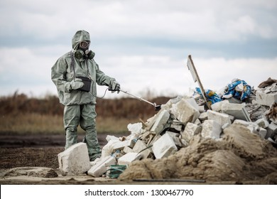 Environmental engineer working on regulation and monitoring of pollution on the municipal landfill in the danger zone