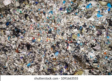 Environmental pollution. Aerial top view photo from flying drone of large garbage pile. Garbage pile in trash dump or landfill.