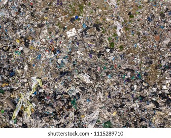 Environmental pollution. Aerial top view photo from flying drone of large garbage pile. Garbage pile in trash dump or landfill