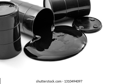Environmental pollution, fossil fuel production and greenhouse gas concept theme with oil barrels and black pool of toxic petroleum spilled leaking from a barrel isolated on white background