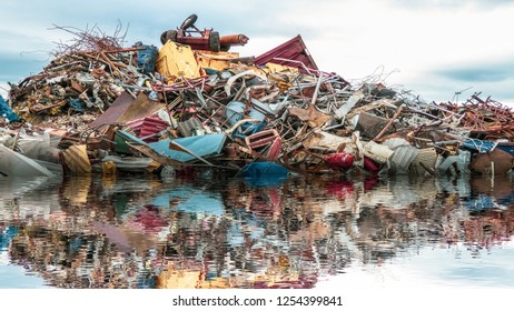 Environmental pollution of the sea. A pile of metal garbage, plastic and junk in the ocean. Concept montage image.