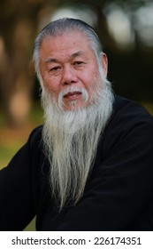 Environmental portrait of a senior man with long beard