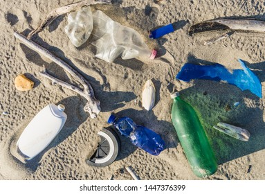 Environmental problem of plastic rubbish pollution in ocean.Spilled garbage on the beach. Empty used dirty plastic bottles. Dirty sea sandy shore the Mediterranean Sea. Environmental pollution.