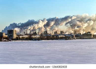 Environmental problem of environmental pollution and air in large cities. Smoke from factory pipes above city
