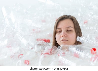 Environmental Protection, people and recyclable plastic concept - exhausted woman concerned with environment disaster sitting in a pile plastic bottles