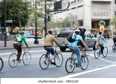 Environmentally conscious bikers in traffic in San Francisco, California. Motion blur on the subjects - faces unrecognizable.