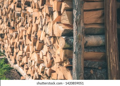 Environmentally friendly fuel. Firewood for a rustic stove. Wood texture. Rustic background Ecologicaly clean fuel. Firewood is laid wall