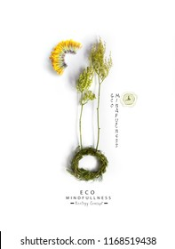 Environmentally friendly planet.Symbolic planet with trees, made of green branches and grass with flower sun. Minimal nature concept.Think Green.Ecology Concept.Flat lay.Top view.