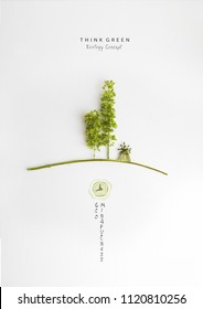 Environmentally friendly planet.Symbolic trees and a mill, made of green, isolated on bright background. Minimal nature concept.Think Green.Ecology Concept.Flat lay.Top view.