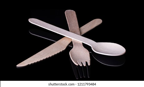 Environmentally friendly wooden cutlery on a black background