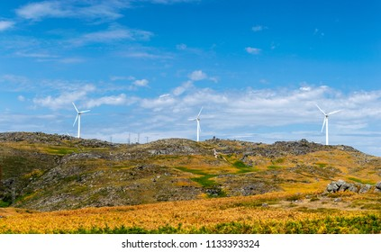 eolic renewable energy with wind turbines on a cloudy ble sky