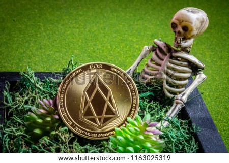 EOS coin in a graveyard and a skeleton.