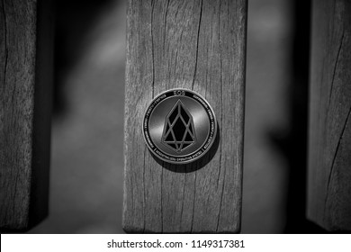 Eos cryptocurrency coin on the wooden bench in black and white