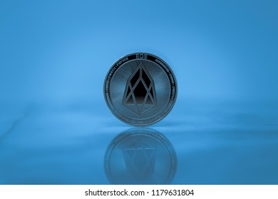 Eos cryptocurrency physical coin on the marble floor with the blue lighting