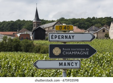 Epernay, France - June 11, 2017: Sign of the Route Touristique du Champagne with in the background vineyards of the Champagne district Vallee de Marne, France.