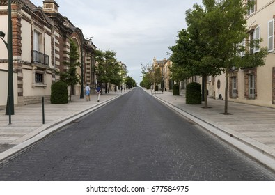 Epernay, France - June 13, 2017: Avenue de Champagne with several Champagne houses along the road with strolling tourists  in the evening in Epernay, France.