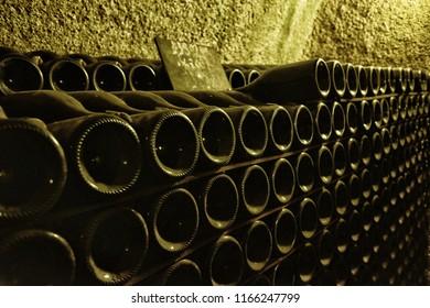 Epernay, France - November 18, 2017: Close up of old vintage bottles of champagne in wine cellars of Moet & Chandon. Champagne winery, Epernay, Champagne Region, France.