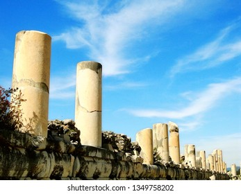 Ephesus, Turkish:Efes, was anancient Greekcity derive fromHittiteApasa.  A landscape with ancient Greek architecture of columns in a beautiful blue sky and white cloud background in a sunny day.