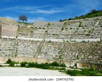 Ephesus, Turkish:Efes, was anancient Greekcity derive fromHittiteApasa.  A landscape with ancient Roma theater architecture in a beautiful blue sky and white cloud background in a sunny day.