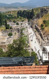 EPHESUS, TURKEY - MAY 25, 2014 - Tourists walk down the main street towards the Library of Celsus  Ephesus, Turkey