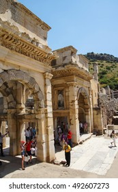 EPHESUS, TURKEY - MAY 25, 2014 - Tourists explore the Library of Celsus in  Ephesus, Turkey