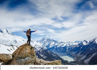 Epic adventure of brave and ambitious hiker trekking activity on wild cliff, pose with panoramic nature mountain landscape