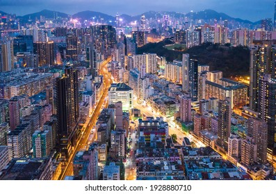 Epic aerial night view of downtown district in Kowloon, Hong Kong.Cyperpunk color