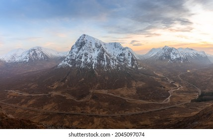 Epic, awe-inspiring panorama mountain landscape view from Stob Beinn a'Chrulaiste, of a snowcapped Buachalle Etive Mor at sunset or sunrise in Glencoe, Scottish Highalnds