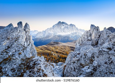 Epic beautiful view at huge white rocks of Dolomiti (Dolomites) mountains. Mountain ridge of Dolomiti mountains at dusk. Passo Falzarego, Italy.
