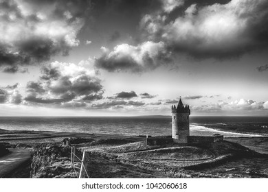 epic black and white Doolin Castle in County Clare, Ireland. scenic irish countryside along the wild atlantic way