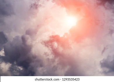 Epic cumulus storm dark clouds background with sun and sunlight. Darkness and light