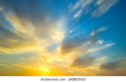 Epic dramatic sunset . Beautiful orange, yellow and blue colors sunset sky for background.