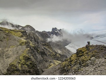 Epic landscape of Skaftafellsjokull Glacier in cloudy summer day: glacier tongue with ice and snow slide down the mountain valley in Skaftafell, Vatnajokull National Park, Southern Iceland, Europe