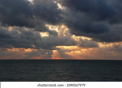 Epic morning sky with the heavy clouds and sun rays which are coming through them. Andaman and Nicobar islands, India.