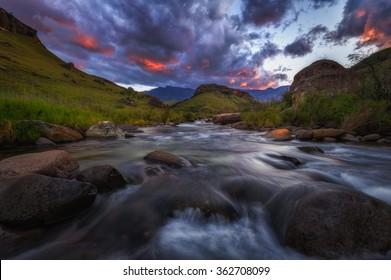 Epic orange sunset over Giants Castle Nature Reserve in the Drakensberg