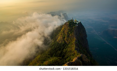Epic picture at sunrise of monastir in the Mount Zwegabin in Hpa-An, Myanma. Amazing aerial view during sunrise at mountain Zwegabin