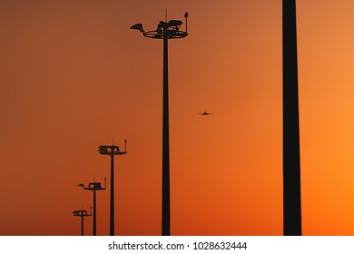 Epic scene of taking off aircraft plane at incredible orange sunset background in airport. Travel or vacation background.