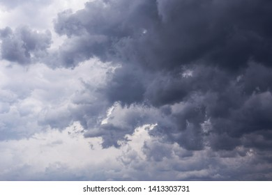 Epic scenic Storm sky, dark clouds background texture. Darkness and light
