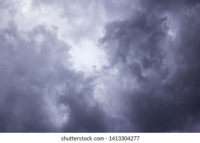Epic Storm sky, dark clouds background texture. Darkness and light