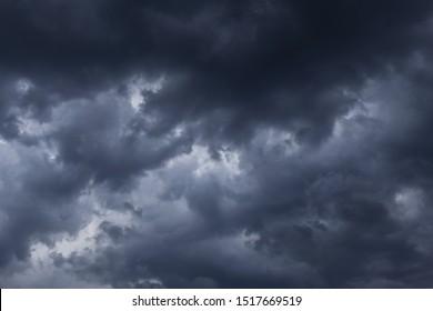 Epic Storm sky, dark grey clouds background texture