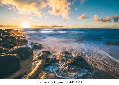 Epic sunrise in Kauai Beach in Hawaii with ocean