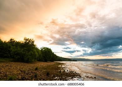 Epic sunset clouds over lake Baikal