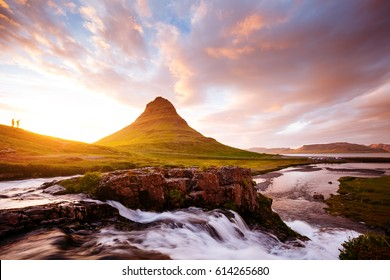 Epic view of Kirkjufell volcano with a small figure of human. Popular and gorgeous scene. Location Kirkjufellsfoss, sightseeing Europe. Wonderful image of wallpaper. Discover the world of beauty.