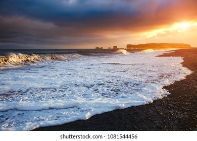 Epic view of Reynisfjara beach and sunny waves. Location cape Dyrholaey, Atlantic ocean near Vik village, Iceland, Europe. Scenic image of beautiful nature landscape. Discover the beauty of earth.
