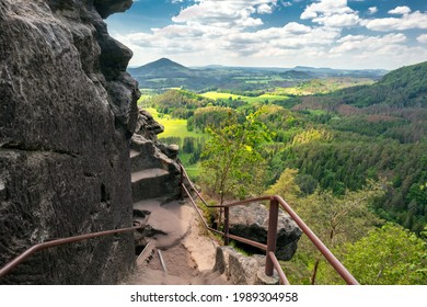 Epic view from Rock of Maria, or Mariina skala, or Marienfels into beautiful landscape of Bohemian Switzerland on a sunny summer day. View from the top of the rock into vast, picturesque landscape. - Shutterstock ID 1989304958
