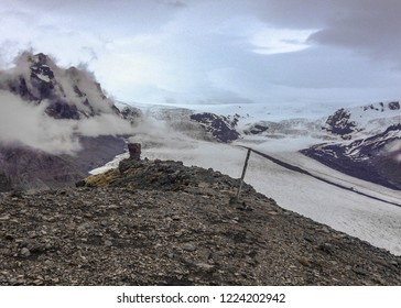Epic view of Skaftafellsjokull Glacier in cloudy summer day: glacier tongue with ice and snow slide down the mountain valley in Skaftafell, Vatnajokull National Park, Southern Iceland, Europe